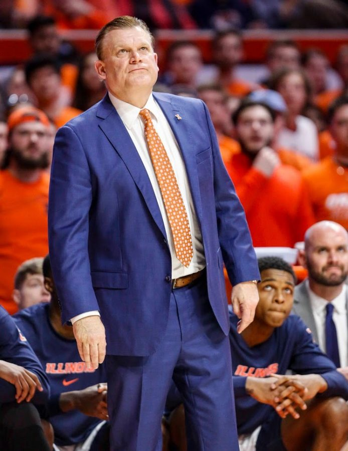 Head coach Brad Underwood looks at the score during the Illinois' game against Iowa at State Farm Center on March 8.