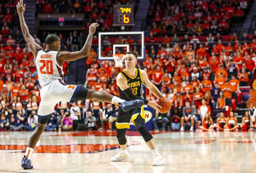 Junior guard Da'Monte Williams defends Iowa sophomore guard Conner McCaffery during the Illini's game agasint the Hawkeyes Sunday night at State Farm Center. Illinois beat Iowa 78-76.