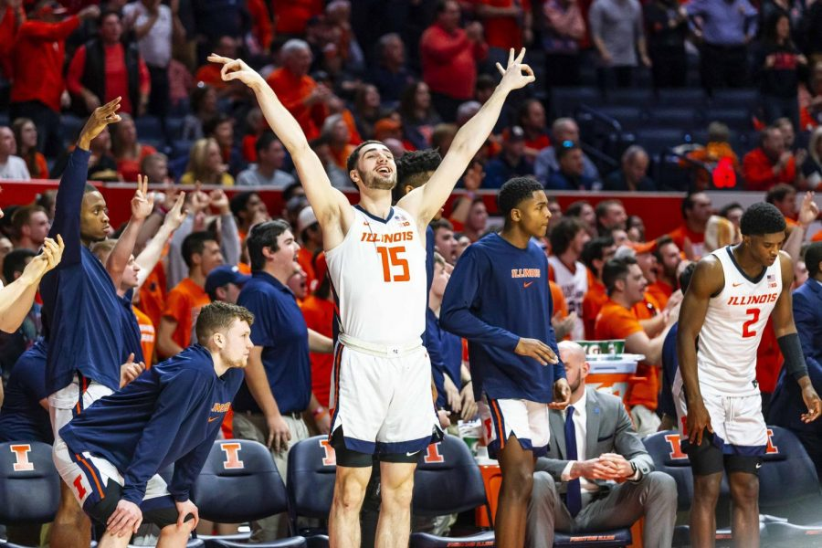 Giorgi+Bezhanishvili+celebrates+on+the+sideline+during+Illinois%27+game+against+Iowa+on+March+8.+The+Illini+won+78-76.