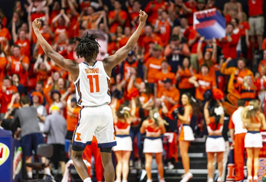 Sophomore guard Ayo Dosumnu raises his arms to the crowd of State Farm Center.