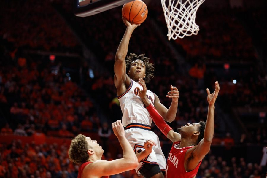 Sophomore guard Ayo Dosunmu rises through two Indiana players for a dunk during the Illini's game against the Hoosiers at State Farm Center Sunday afternoon. Illinois outplayed Indiana, 67-66 and bounces back into the Associated Press top-25 poll for the first time in three weeks.