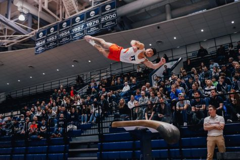 Sophomore Clay Stephens competes in the Vault event during a match against Penn State on March 16, 2019.
