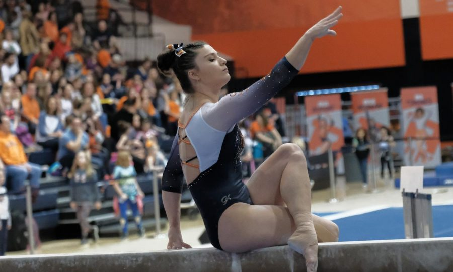 Senior Karen Howell does her beam routine against Central Michigan on Senior Day at Huff Hall on March 1. Howell scored a 9.650 on the beam and the Illini won the meet with a score of 196.225-195.500.