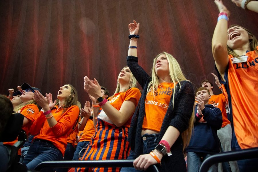 Students+in+the+student+fan+section+cheer+for+the+Illini+Mens+Basketball+Team+during+the+match+against+Iowa+on+March+8.+The+Illini+won+78-76