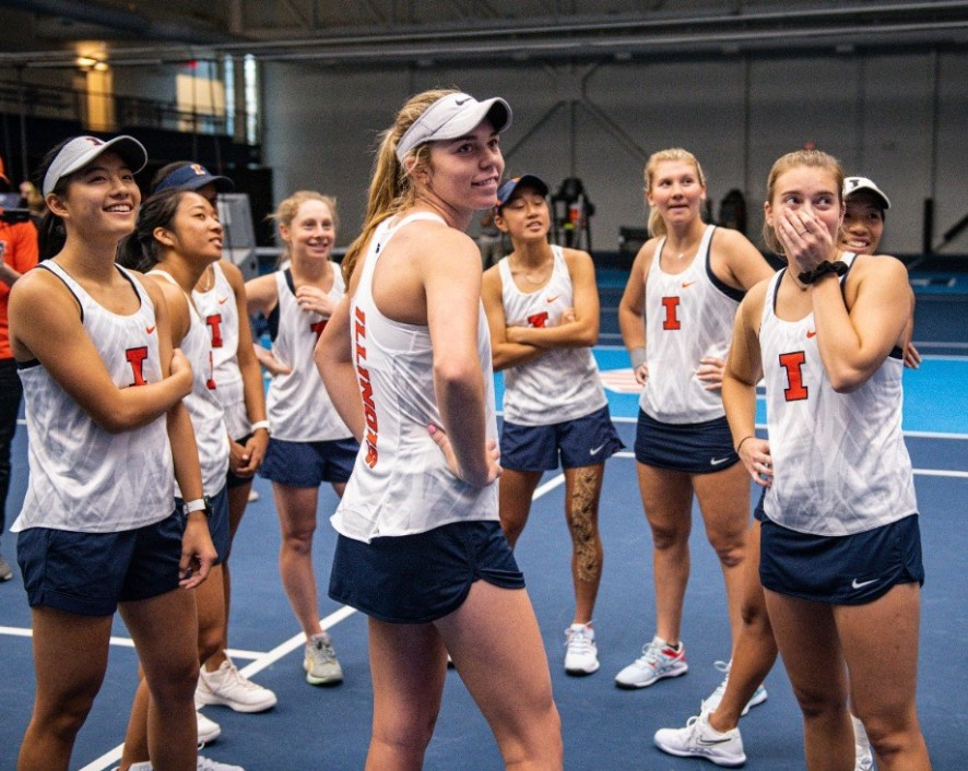 Freshman+Josie+Frazier+stands+and+laughs+after+a+team+huddle+during+the+meet+against+Eastern+Michigan+on+Jan.+26.