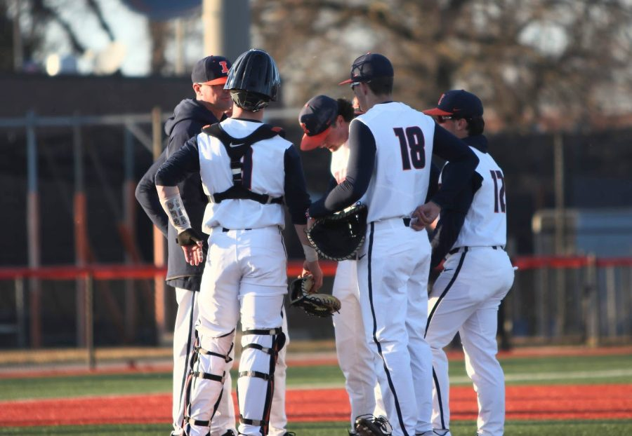 The Illinois baseball team gathers at the pitching mound during the Illinois' game against Chicago State at Illinois Field on March 3.