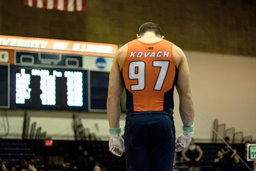 Junior Jordan Kovach bows his head down during the Illinois' meet against Penn State at Huff Hall on March 7.
