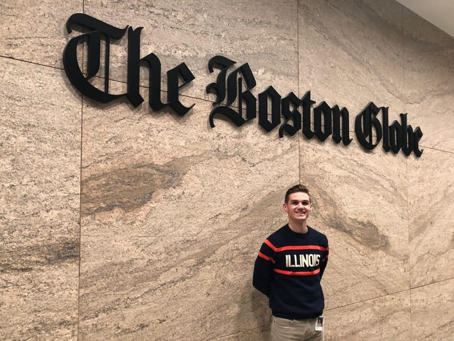 Peter+Bailey-Wells+stands+in+front+of+the+Boston+Globe+Sign.
