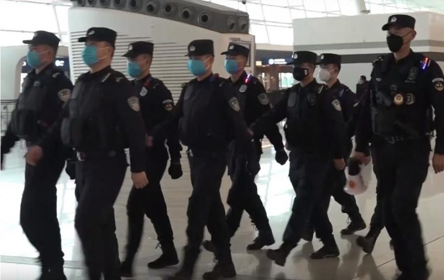 Policemen+wearing+protective+masks+patrol+the+Wuhan+Tianhe++International+Airport+during+the+coronavirus+outbreak+on+Jan.+22.