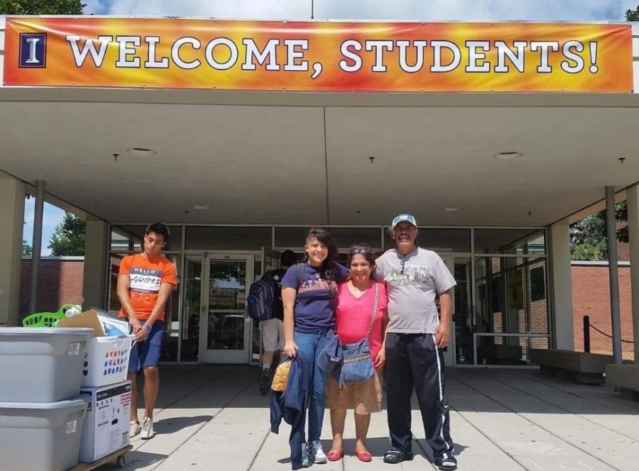 Cristal Caballero, the author of the letter sent to University administration, stands with her parents outside of her dorm building on move in day.