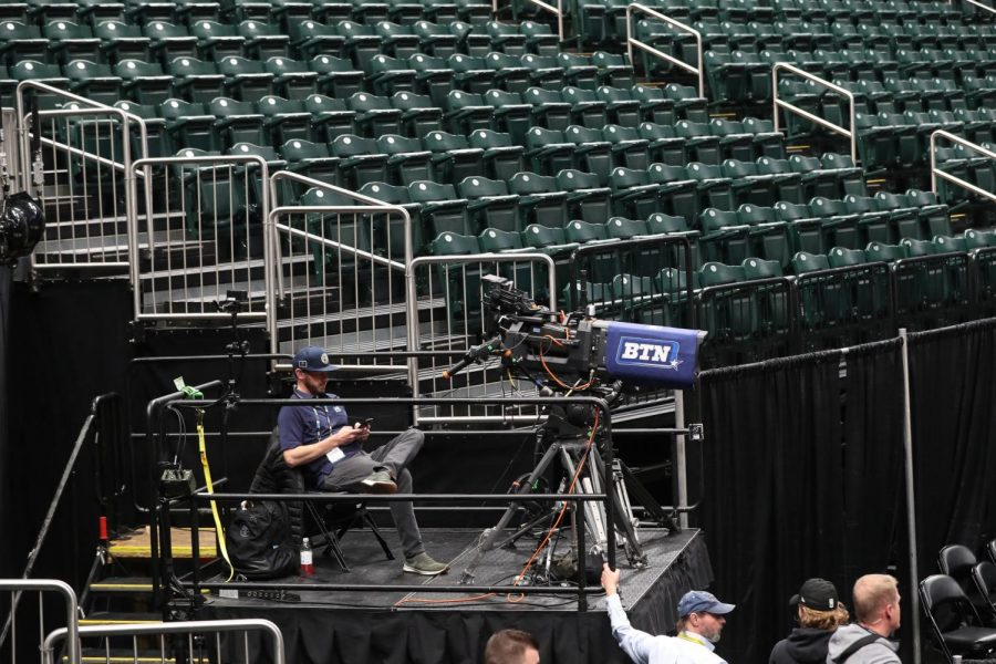 With empty stands all around, a Big Ten Network camera operator waits to cover the first game on day 2 of the men's Big 10 basketball tournament at Bankers Life Fieldhouse in Indianapolis on March 12.