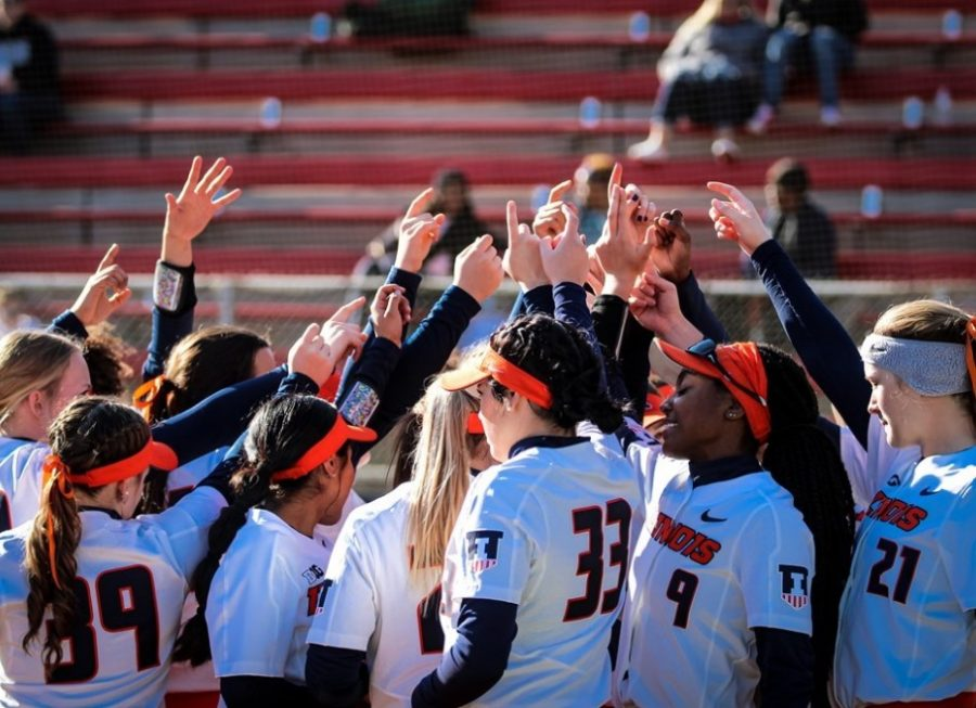 The Illini softball team huddles before the game against Notre Dame on Feb. 15 at Melissa Cook Stadium. The Illini lost 10-1.