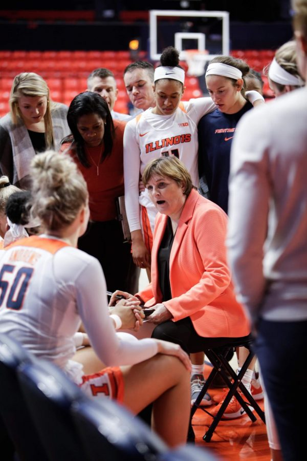 Head women's basketball coach Nancy Fahey talks with the Illini during a break at State Farm Center as Illinois faced off against Indiana on February 13. Illinois' season was sealed during the first round of the Big Ten Tournament in Indianapolis Wednesday afternoon. The Illini fell to the Wisconsin Badgers 71-55.