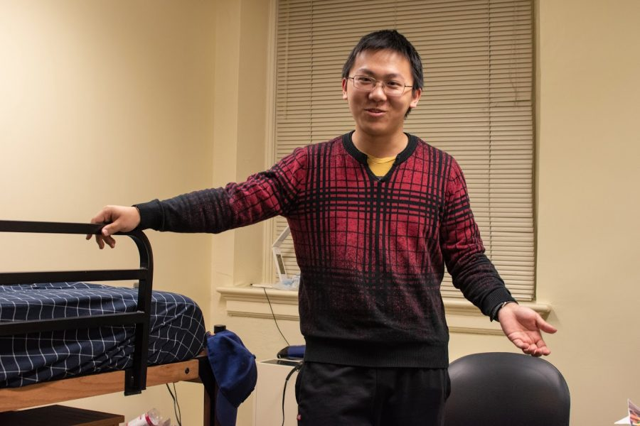 Yuanrui Chen, sophomore in Engineering, stands in his single dorm room located at Busey-Evans Residence Hall. Some dorms and dining halls will remain open through Continued Housing despite the University's transition to online classes.