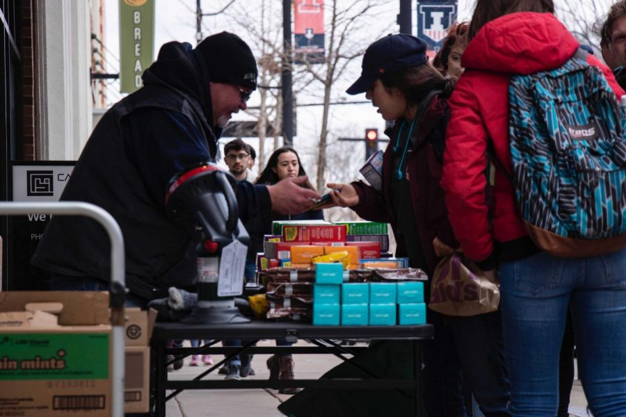 Students purchase cookies from a Girl Scout stand on Unofficial.