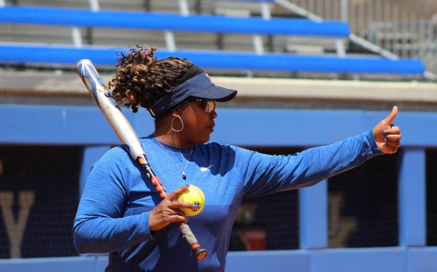 Head coach Tyra Perry holds her thumb up during an Illinois softball practice at Eichelberger Field/