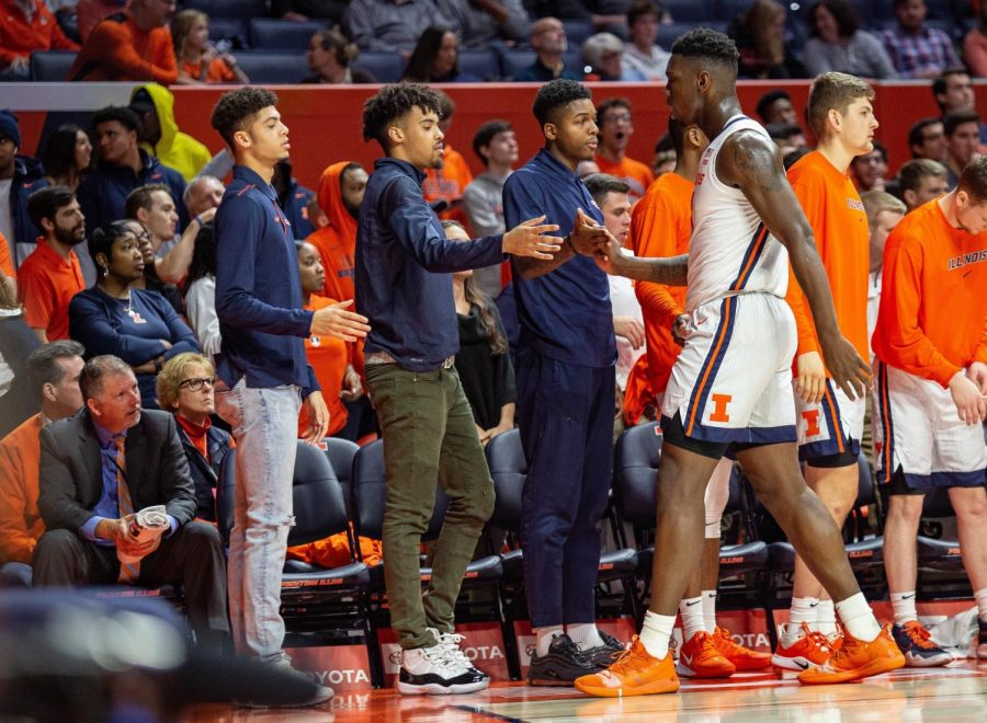 Junior+Jacob+Grandison+gives+Kofi+Cockburn+a+high+five+after+a+play+against+Nicholls+State+at+State+Farm+Center+on+Nov.+5%2C+2019.+The+Illini+won+78-70.