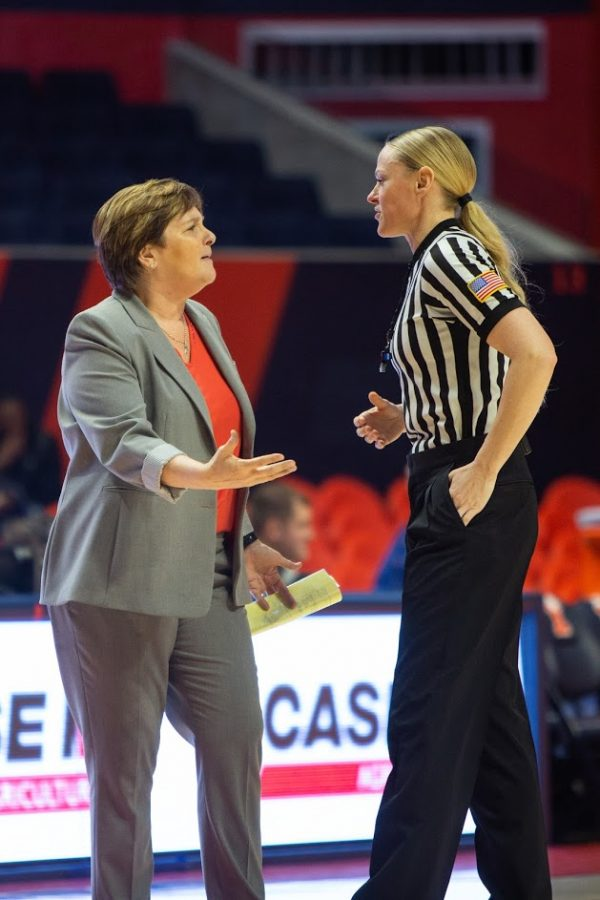 Illinois Women's Head Basketball Coach Nancy Fahey speaks with a referee during the match against Ohio State on Feb. 6 at State Farm Center.
