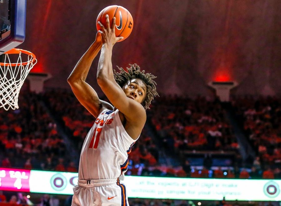 Sophomore Guard Ayo Dosunmu captures a rebound during the match against Iowa on March 8.
