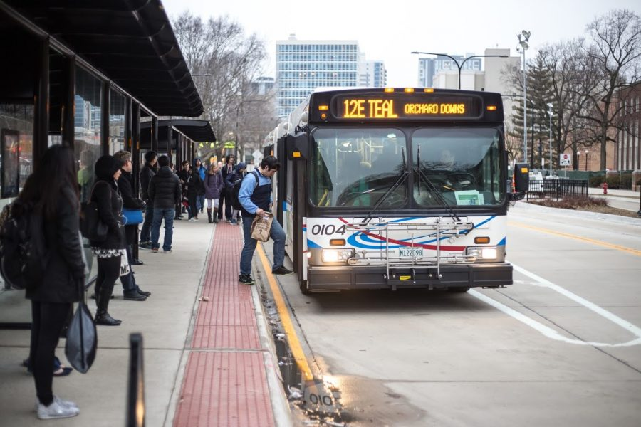 Students climb aboard an MTD bus at the Union bus stop on Feb. 23, 2018.