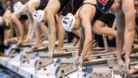 Sophomore Kaylee Heimes readies herself on the starting block during a swim meet.
