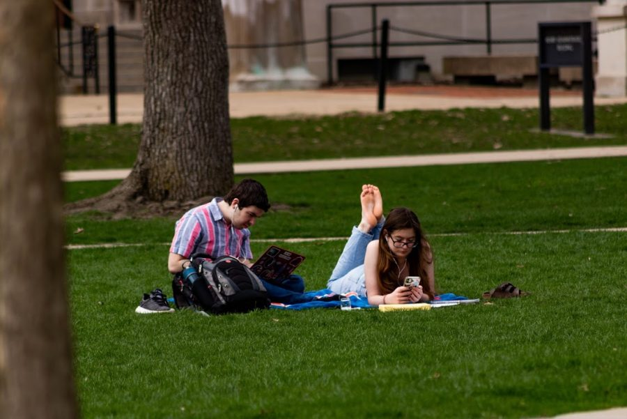 Two University of Illinois students relax on the quad April 4, 2020.