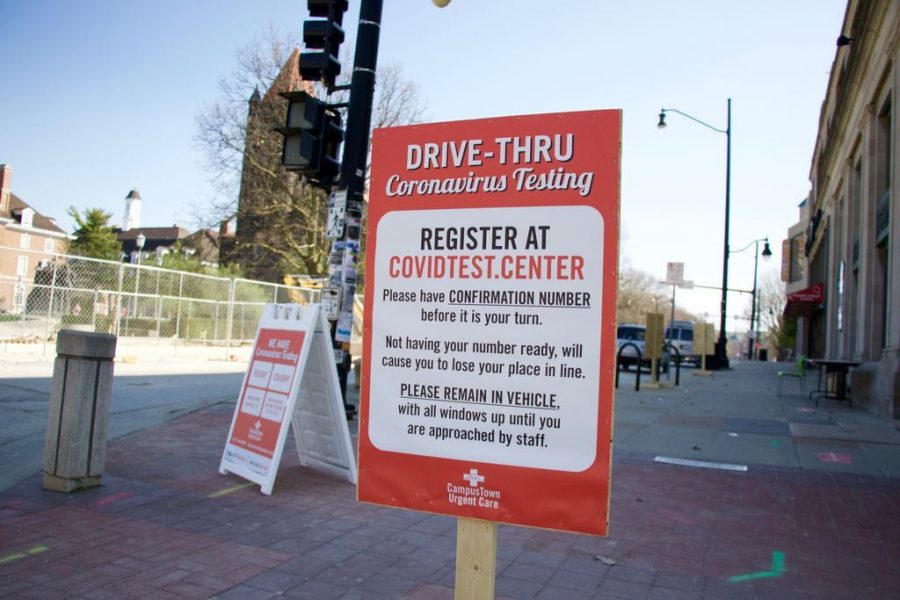A sign outside CampusTown Urgent Care tells patrons how to use their new drive-thru Coronavirus testing services on Tuesday.