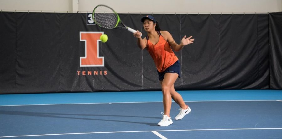 Senior+Madeleine+Gandawidjaja+returns+the+ball+during+a+match.