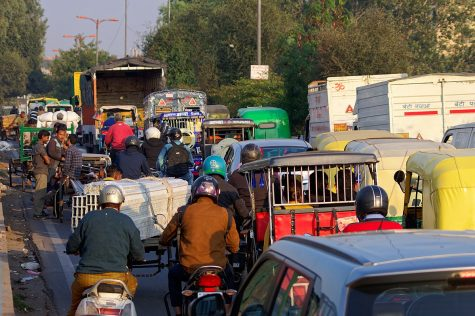 A New Delhi street is filled with early afternoon traffic on Dec. 3, 2019. Some international students forced to move back home to places like India are struggling with the time zone difference.