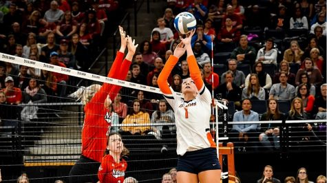 Former Illini volleyball player Jordyn Poulter tips the ball over the net.