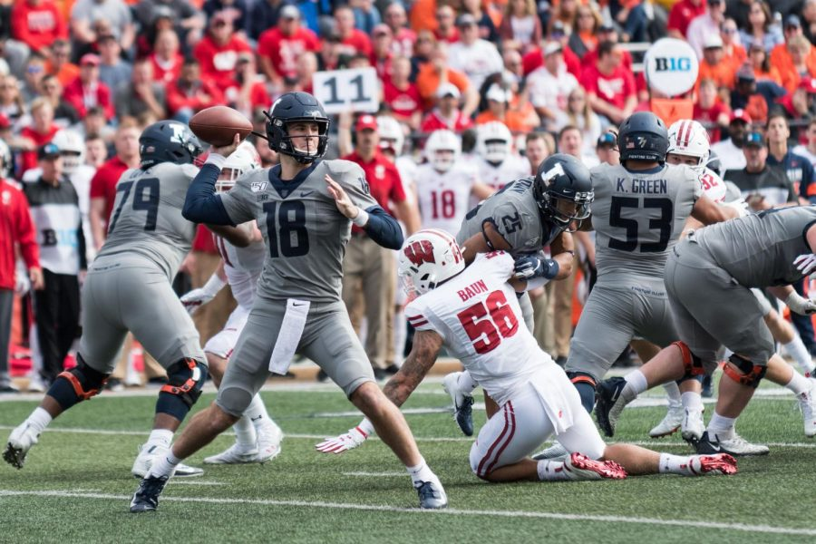 Illinois quarterback Brandon Peters throws a pass during the game against Wisconsin.  The Illini won 24-23.