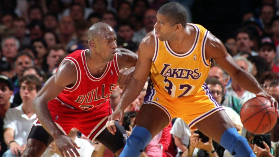 Lakers Point Guard Magic Johnson tries to drive past Chicago Bulls player Michael Jordan during the 1991 NBA Finals.