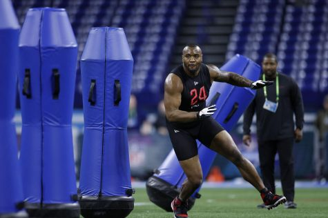 Defensive lineman Raekwon Davis of Alabama runs a drill during the NFL Combine at Lucas Oil Stadium in Indianapolis on Feb. 29, 2020.