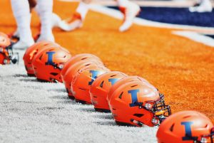 Illinois football helmets line up at the end zone at Memorial Stadium during football spring training on April 13, 2019.
