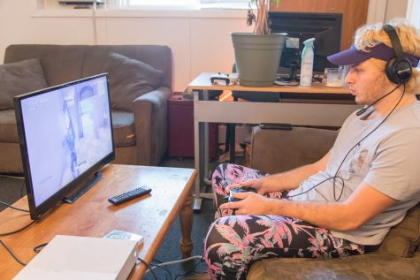 Mike Hoke plays a game of Fortnite in his apartment on Oct. 13, 2018. Students stuck at home during quarantine can ease their boredom with video games like Fortnite activities.