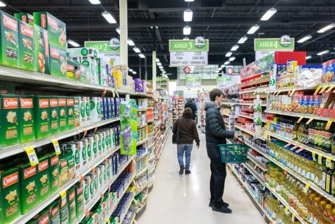 Customers shop at the County Market in Champaign, IL on Feb. 16.