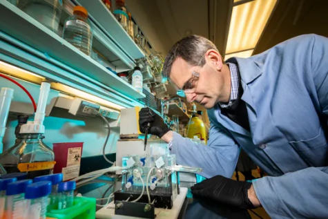 Martin Burke works in the Roger Adams Laboratory in Urbana, IL. Burke is the co-author of the new treatment being developed to treat all types of cystic fibrosis.