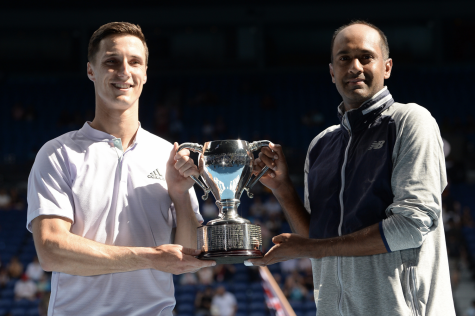 Joe Salisbury (left) and Rajeev Ram (right) pose with their trophy after the pair won the Australian Open men's doubles competition on Feb. 2. The win was Ram's first men's doubles Grand Slam title.