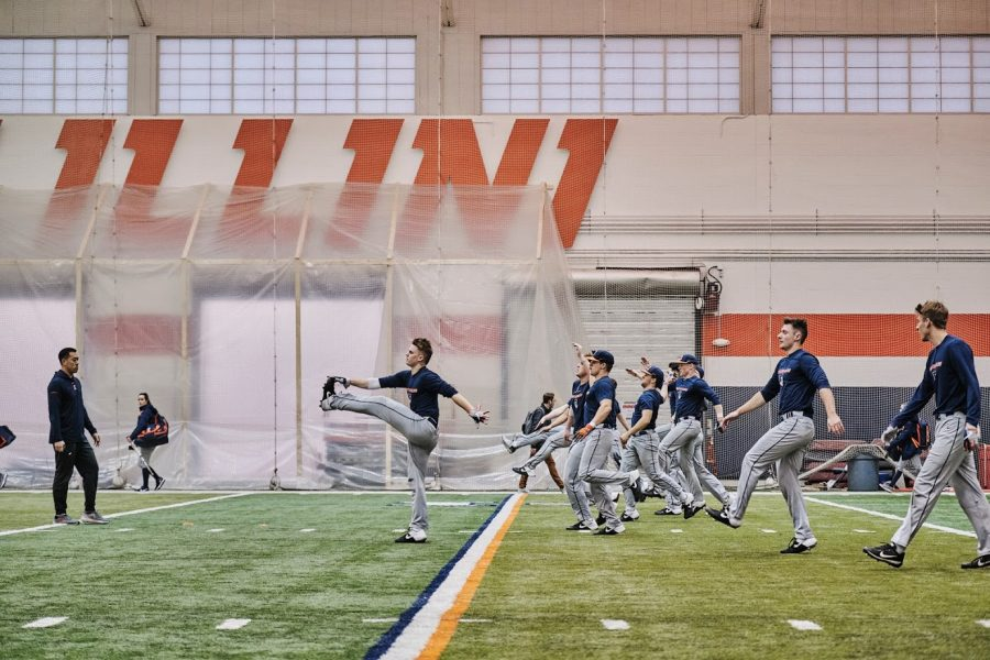 Members+of+the+Fighting+Illini+Baseball+Team+complete+warmups+before+practice+on+Feb.+10%2C+2019