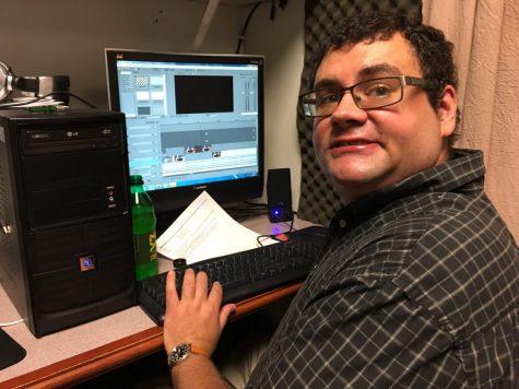 Urbana Public Television Producer Andrew Scolari edits video at his workstation.