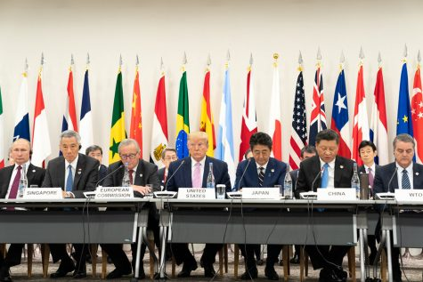 President Donald J. Trump, seated next to Japanese Prime Minister Shinzo Abe, listens as China's President Xi Jinping, right, delivers remarks at the G20 Leaders Special Event on the Digital Economy at the G20 Japan Summit Friday, June 28, 2019, in Osaka, Japan.