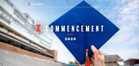 A person holds a graduation cap in the air at Memorial Stadium.