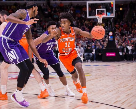 Illinois Guard Ayo Dosunmu dribbles around a defender during the game against Northwestern in the first round of the Big Ten Tournament at the United Center on Wednesday, March 13, 2019.