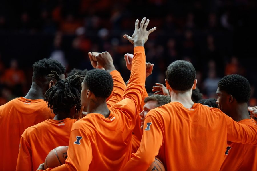 The Illinois Men's Basketball team huddles before a match with Indiana on March 1.
