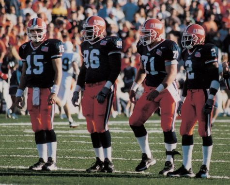 The Illinois offensive line stands on the field before a play during the 2001 season.