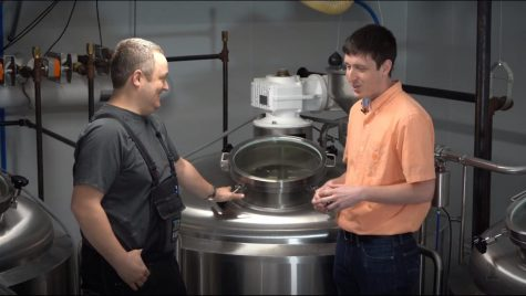 FSHN 175 Teaching Assitsant Max Holle (right) takes an on-site tour of Riggs Beer Company with Darin Riggs (left) for a video for his class.