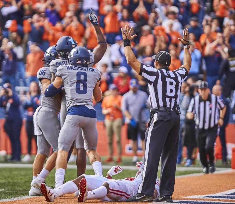 Sophomore wide receiver, Casey Washington, congratulates his teammates after scoring a touchdown against the Wisconsin Badgers on Oct. 19, 2019 at Memorial Stadium.