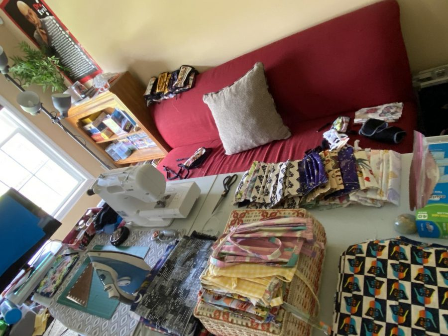 A sewing station where CU Mask Makers created face masks for the coronavirus pandemic sits in a livingroom.