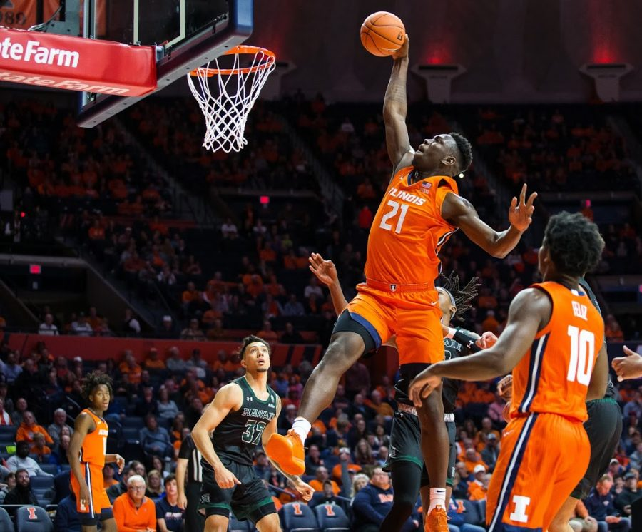Freshman+Center+Kofi+Cockburn+dunks+the+ball+during+the+match+against+Hawaii+on+Nov.+18%2C+2019.+Cockburn+has+entered+the+transfer+portal+while+keeping+his+name+in+the+NBA+Draft.