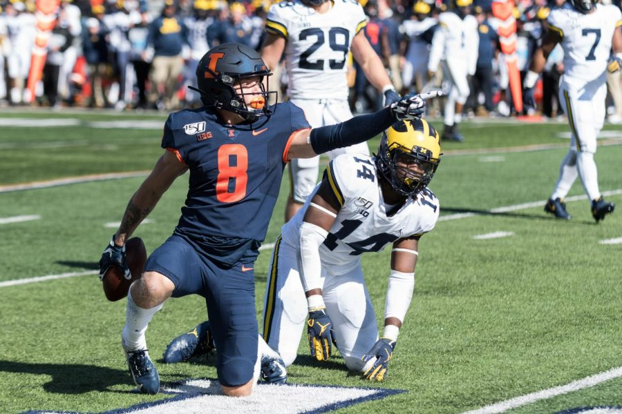 Illinois+freshman+wide+receiver+Casey+Washington+celebrates+a+first+down+during+the+game+against+Michigan+on+Saturday%2C+Oct.+12.++The+Illini+lost+25-42.